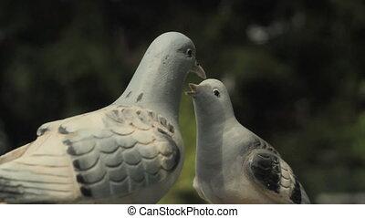 Pigeon sculpture. - Rotating wooden pigeon sculpture. Mother...
