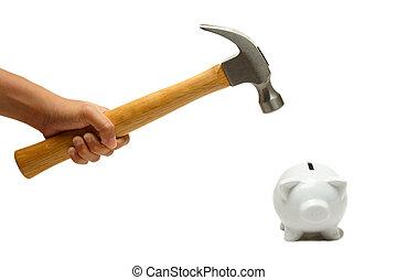 Piggy bank - A shot of a hammer breaking a piggy bank