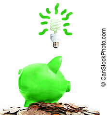 piggy bank and assorted coins with green idea, on white