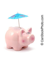 piggy bank and cocktail umbrella isolated on white...