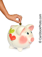 Piggy bank and hand with coin isolated