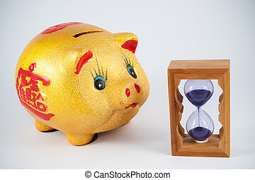 Piggy bank and hourglass