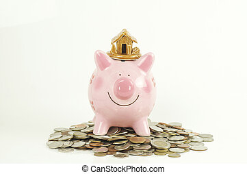 piggy bank and house and home on pile of money coin isolated on white background