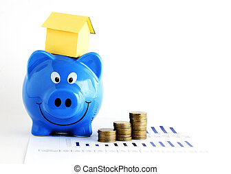 Piggy bank and house paper and coins stack for home loans concept