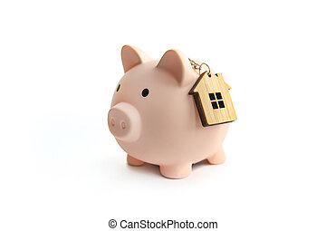 Piggy bank and key house isolated against white background. concept of saving up for your real estate. Save on rent.