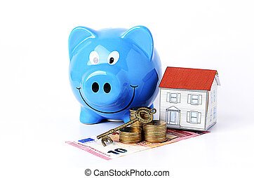 piggy bank and paper house and key with coins stack for mortgage loans concept