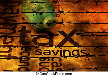 Piggy bank and tax concept against barbwire