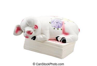 Piggy Bank Asleep On Phony Money Stack.
