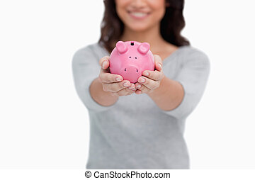 Piggy bank being held by woman