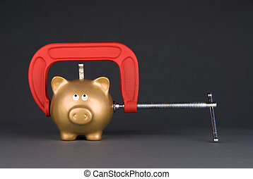 A golden piggy bank is being squeezed for its last dollar. Image can be used for many financial inferences, including recessuion; savings; economy; retirement; investment and poverty.