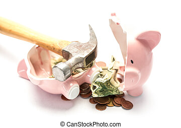 Piggy bank broken with money and hammer on white background