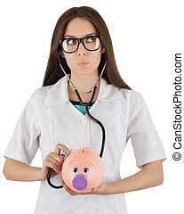 Woman doctor checking how healthy a piggy bank is, isolated on white background.