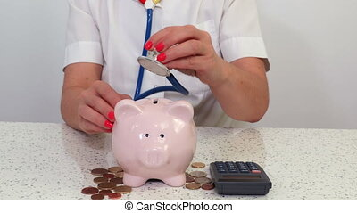 Piggy bank concept with doctor and stethoscope