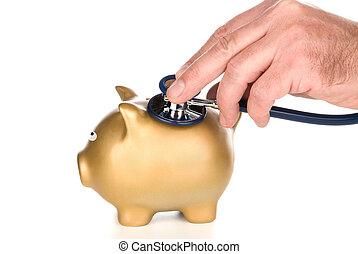 A golden piggy bank is being examined for life after tough economic times. Image can be used for medical and financial inferences.