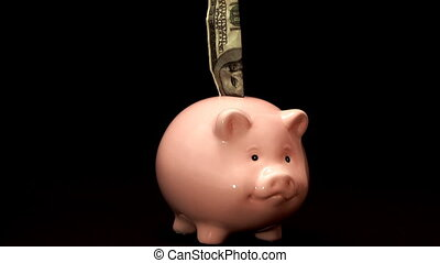 piggy bank on black background in her fall bills
