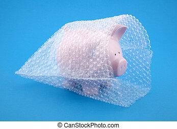 Piggy bank in bubble wrap