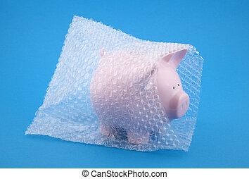 Piggy bank in bubble wrap