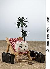 piggy bank in deck chair - a piggy bank lies in a deck...