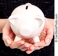 Piggy bank in woman hands