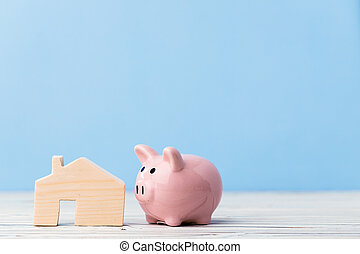 Piggy bank money box with wooden house model