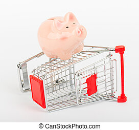 Piggy bank on shopping cart, side view