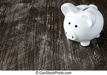 Piggy bank on the black surface