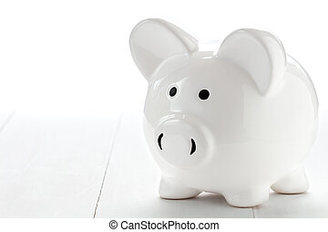 Piggy bank on white wooden floor