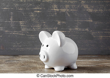 Piggy bank on wooden background