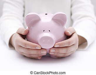 Piggy bank protected by hands