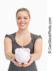 Piggy bank showing by a woman