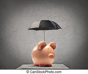 piggy-bank with umbrella on gray background