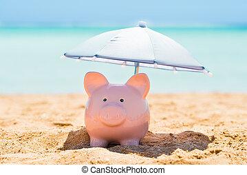 Piggy Bank Under The Parasol At Beach