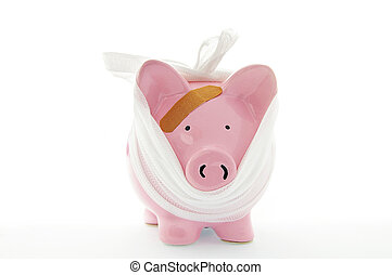 piggy bank with bandage on white
