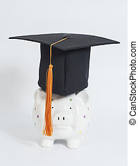 Piggy bank with black graduation hat