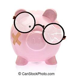 Piggy bank with broken eyeglasses and bandage