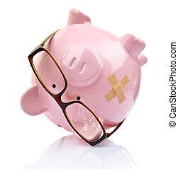 Piggy bank with broken eyeglasses and bandage upside down