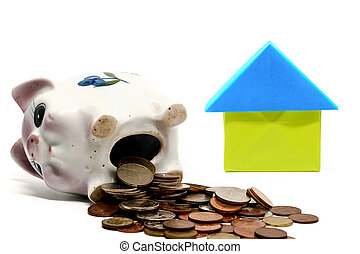 Piggy bank with coins and paper house origami on white background