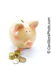 Piggy bank with coins isolated with copy-space