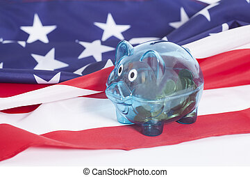 Piggy bank with  coins on American national flag