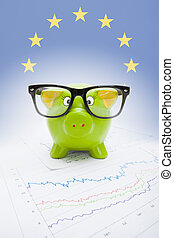 Piggy bank with flag on background -