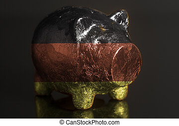 Piggy bank with German flag