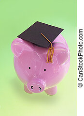 piggy bank with graduation cap on green ( cost of education )
