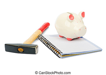 Piggy bank with hammer on white