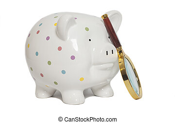 Piggy bank with magnifying glass isolated on white