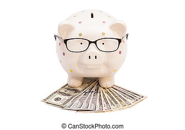 Piggy bank with money and glasses isolated on white background