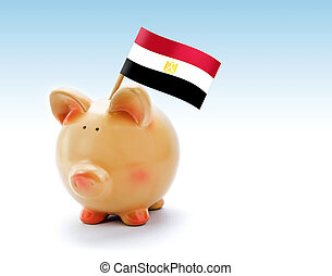 Piggy bank with national flag of Egypt