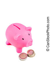Piggy bank with pile of coins