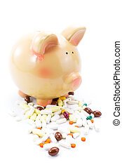 Piggy bank with pile of pills isolated on white