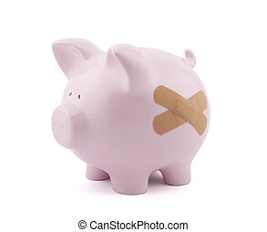 Piggy bank with plaster. Clipping path included.