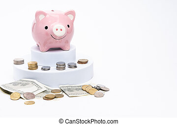 Piggy bank with scattered coins